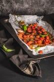 Зажаренные в духовке tomotoes вишни Стоковая Фотография
