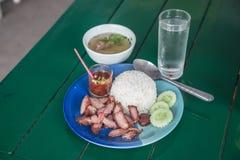 Зажаренные в духовке свинина и рис Стоковые Фото