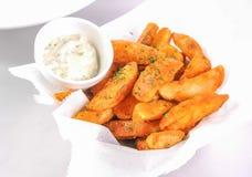 Зажаренные картошка и sause стоковое фото rf