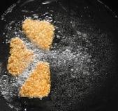Зажаренные обвалянные в сухарях рыбы Стоковые Изображения