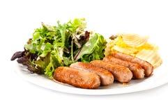 Зажаренные овощи и обломоки сосисок Стоковые Фото