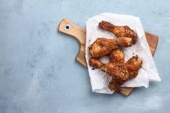зажаренный в духовке drumstick цыпленка Стоковые Изображения RF