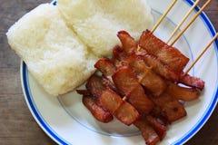 Зажаренный свинина с липким рисом, Таиландом. Стоковая Фотография