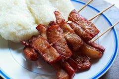 Зажаренный свинина с липким рисом, тайской едой стиля. Стоковая Фотография RF
