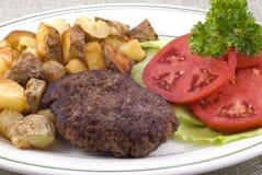 зажаренный стейк картошек диска гамбургера Стоковое Изображение