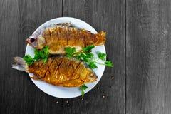 2 зажаренных рыбы Стоковая Фотография