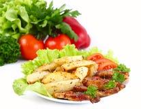 Зажарьте в духовке с картошками и овощами Стоковые Фото