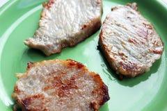 зажженная плита мяса Мясо свинина стоковая фотография