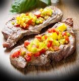 Зажженное мясо стейка Стоковая Фотография