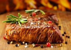 Зажженное мясо с розмариновым маслом Стоковая Фотография RF
