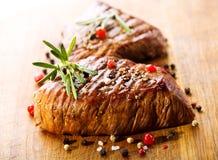 Зажженное мясо с розмариновым маслом Стоковое Фото