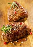 Зажженное мясо с розмариновым маслом Стоковая Фотография