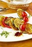 Зажженные овощи и оладььи картошки Стоковые Фотографии RF