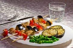 зажженные овощи плиты мяса Стоковое Изображение RF