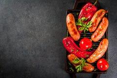 Зажженные сосиски и овощи Стоковые Изображения RF