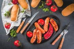 Зажженные сосиски и овощи Стоковая Фотография RF
