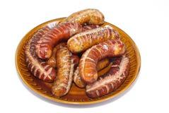 зажженные сосиски плиты Стоковая Фотография RF