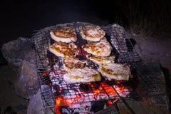 Зажженные стейки свинины Стоковые Изображения RF