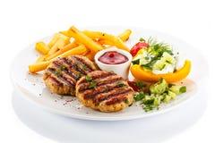 Зажженные стейк и fries франчуза Стоковая Фотография RF