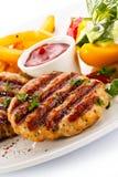 Зажженные стейк и fries франчуза Стоковое Фото