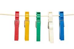 Зажимки для белья вися на веревочке любят гирлянда Стоковые Фотографии RF