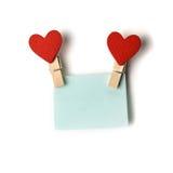 Зажимки для белья при красные сердца держа голубой стикер Стоковые Изображения RF