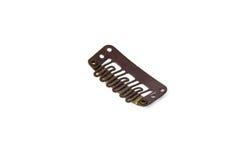 Зажим в зажимах расширения - коричневый цвет Стоковое Фото