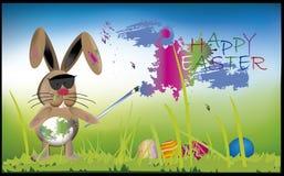 Зайчик крася пасхальные яйца Стоковые Фотографии RF