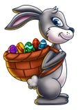 Зайчик пасхи нося корзину яичек 1 Стоковые Фото