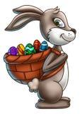 Зайчик пасхи нося корзину яичек 2 Стоковые Фото