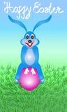 Зайчик пасхи сидя на яичке Стоковые Фото