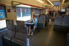 Закоммутируйте поезд внутренний с сидеть пассажира стоковые изображения rf