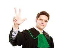 Закон Юрист человека в польской мантии рассчитывать пальцы Стоковое Изображение