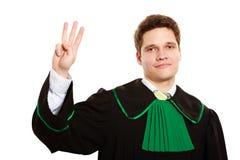 Закон Юрист человека в польской мантии рассчитывать пальцы Стоковая Фотография RF