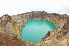 Заколдовыванное или заколдованное озеро, озера кратер Kelimutu Стоковое фото RF
