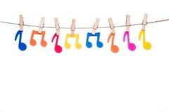 Закрепите на шпагате, вися красочный символ музыки Стоковые Изображения