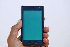 закреплять клетки легкий редактирует включенный рукой экран телефона путя Стоковая Фотография RF