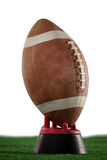 Закройте вверх американского футбола на тройнике на поле Стоковое Изображение RF