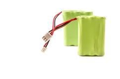 Закройте вверх батареи покрытой при зеленая пластмасса изолированная на белой предпосылке Стоковая Фотография RF