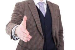 Закройте вверх бизнесмена давая руку для рукопожатия изолированного на wh Стоковые Фотографии RF