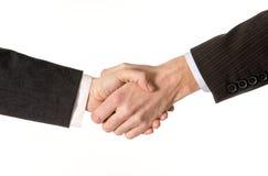 Закройте вверх бизнесмена тряся руку с бизнес-леди Стоковая Фотография