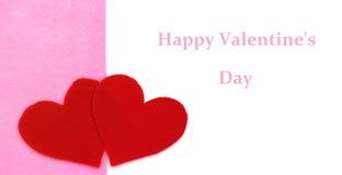 Закройте вверх бумажных форм сердца на розовой и белой предпосылке Стоковое Изображение