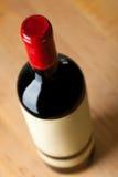 Закройте вверх бутылки красного вина Стоковые Фото