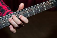 Закройте вверх гитариста Стоковые Фото