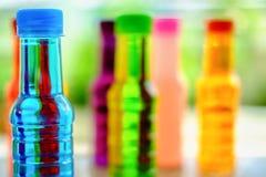 Закройте вверх голубой выпивая бутылки Стоковое Изображение RF
