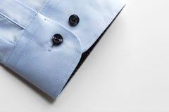 Закройте вверх голубого рукава рубашки Стоковая Фотография RF