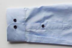 Закройте вверх голубого рукава рубашки Стоковая Фотография