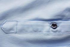 Закройте вверх голубого рукава рубашки Стоковое Фото