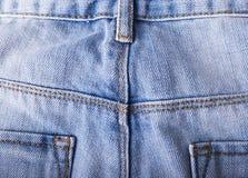 Закройте вверх голубых джинсов, текстуры голубых джинсов Стоковая Фотография