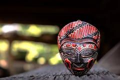 Закройте вверх деревянной маски стоковая фотография